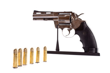 Bullets and revolver. Not real gun (lighter)