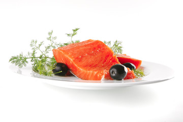 pink salmon on white plate with olives
