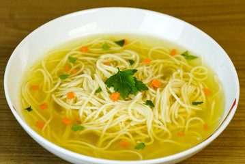 Noodle soup in white bowl