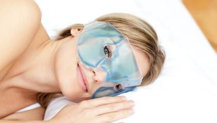 Peaceful woman with an eye gel mask