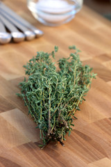 thyme on fine wood cutting board