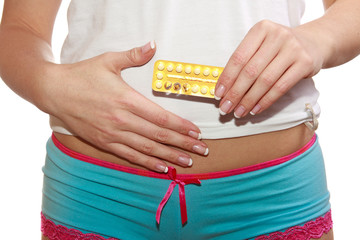 Woman belly in panties with birth control pills