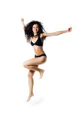 Cute women in swimsuit jumping
