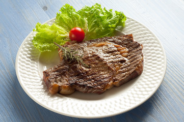 grilled porterhouse with salad