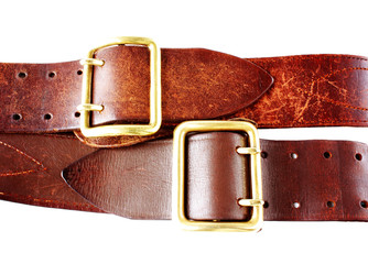 old leather belts on white