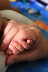 Adult child hand