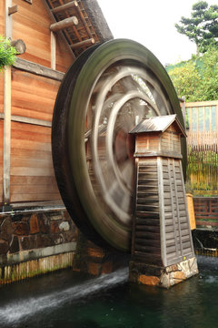 wooden waterwheel rotating.