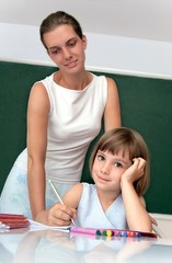 Pupil working under the supervision of a teacher