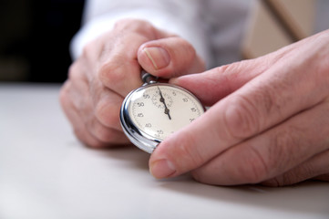 businessman's hand  with stopwatch