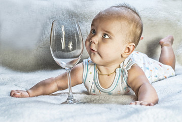 The baby with a glass