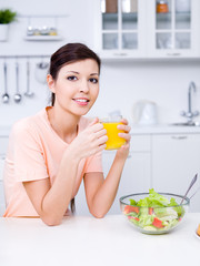 Woman with fresh orange juice