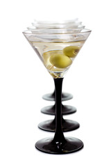 Martini with olives on a white background