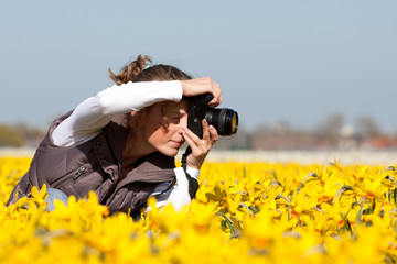 Girl making pictures of flowers