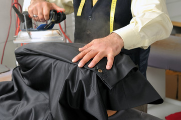 Tailor using iron - a series of TAILOR related images.