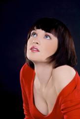 Beautiful brunette girl posing in studio on dark background