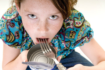 Young girl eating from can