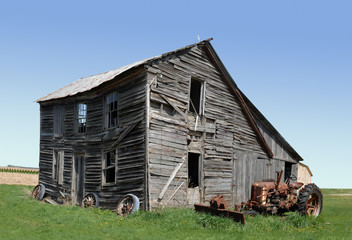 abandoned building and tractor