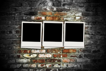Three Blank Photos on Brick Background
