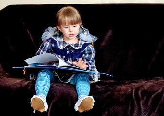 little girl reads book