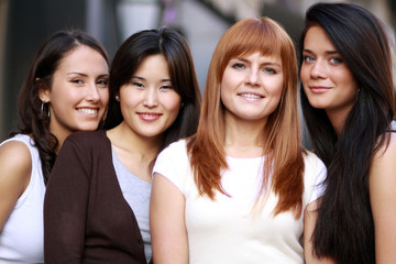 Close-up portrait of four urban women outside