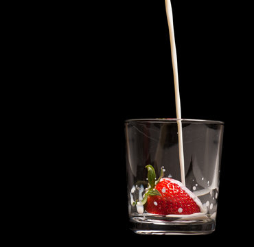 Strawberries in a glass on black background