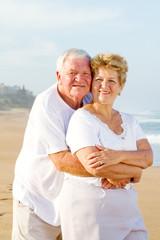 loving elderly couple on beach