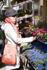 Caucasian young woman shopping in flower shop