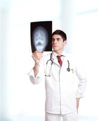 doctor holding up xrays.