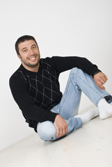 Attractive man sitting on floor