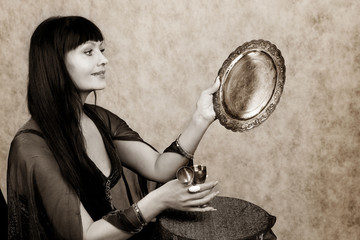 Beautiful woman   and silver wineglass