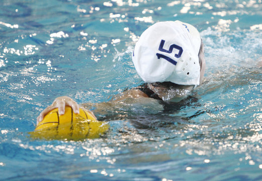Female water polo player during a game.