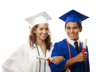 graduates in cap and gown with their diplomas