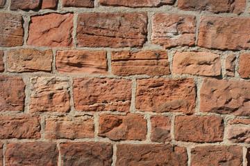 Steinwand mit Sandsteinen