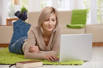 Woman browsing internet on laptop
