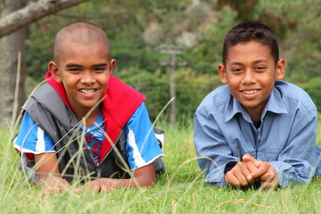 Young school boys smiling and relaxing in a park - Canon 5D MKII