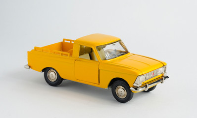 yellow car toy isolated on white