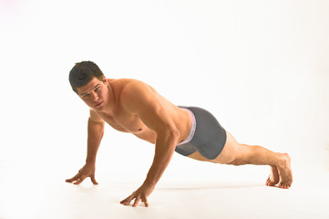 white male athlete performs finger pushups
