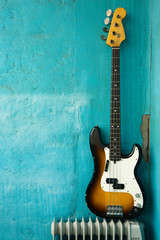 Guitar on blue background, bass on grunge wall