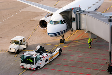 Airport. Airplane is being serviced by the ground crew.