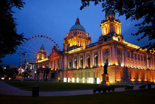 Belfast City Hall and Belfast Eye at dusk.