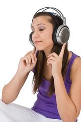 Happy teenager woman enjoy music with headphones
