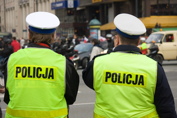 Two unrecognizable polish police officers on a street