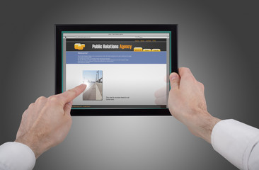 male hand holding a touchpad pc and surfing the web