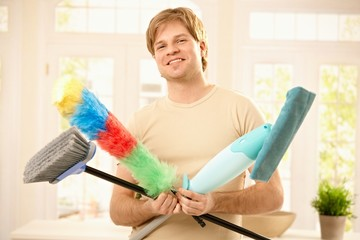 Confident guy with cleaning tools