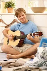 Lazy guy playing guitar