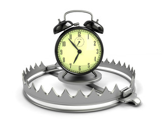 Time management concept. Alarm clock on bear trap.
