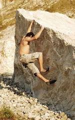 climbing a boulder