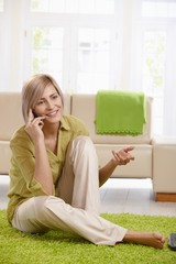 Woman talking on cell at home