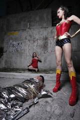 Superhero standing over the evil villain