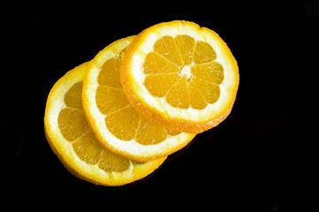 Keuken foto achterwand Plakjes fruit black orange
